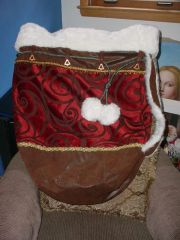 Transporter Santa Bag, shoulder strap, with slide closure, and magic liner.