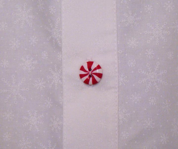pepper mint candy button close up on shirt
