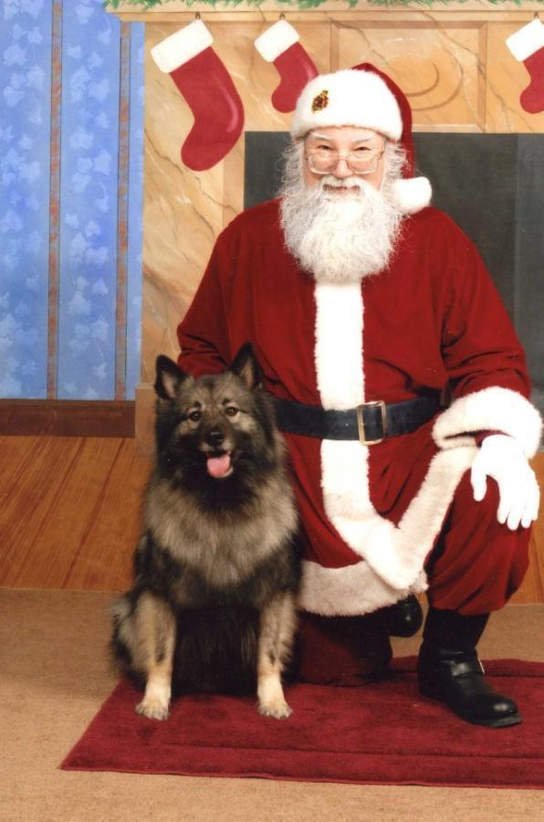 Santa with one of his own dogs, Boomer!