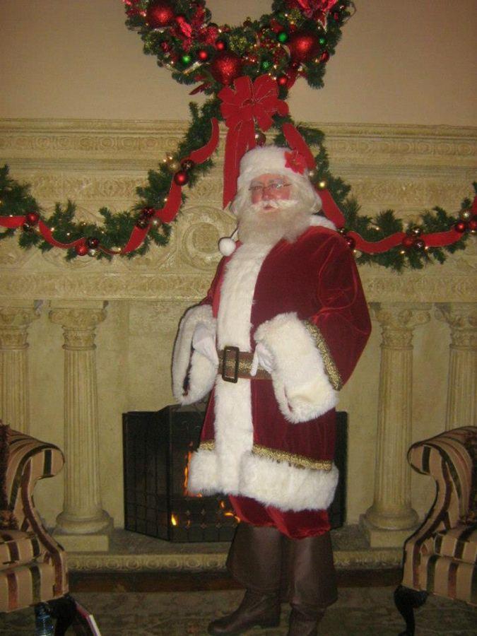 Santa Oliver by fireplace