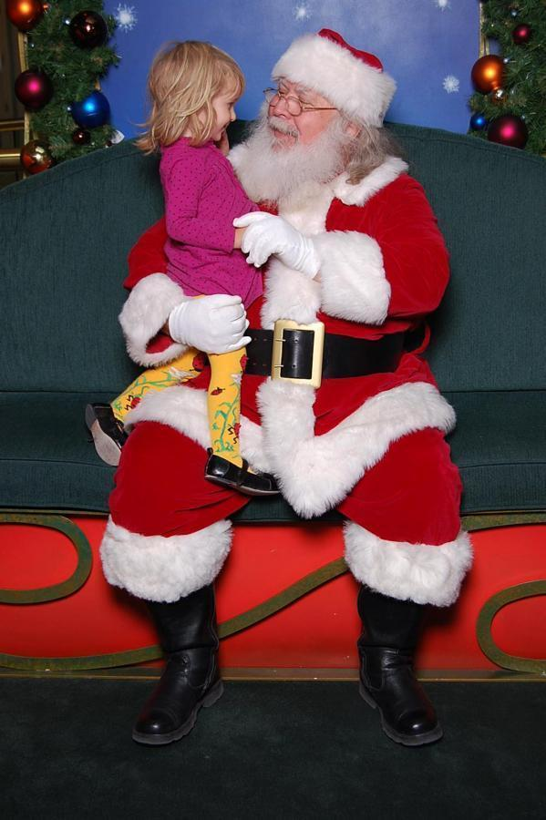 Santa and little girl in discussion