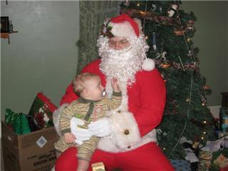 santa getting his beard pulled by his youngest.jpg