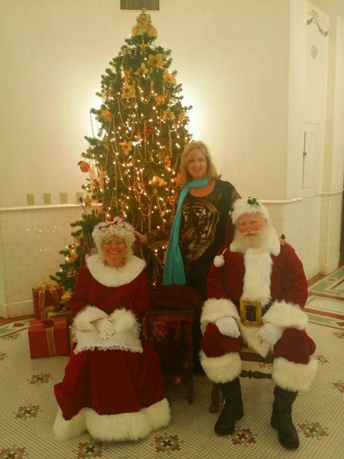 City commissioner Pfiffer with Santa and Mrs. Claus.
