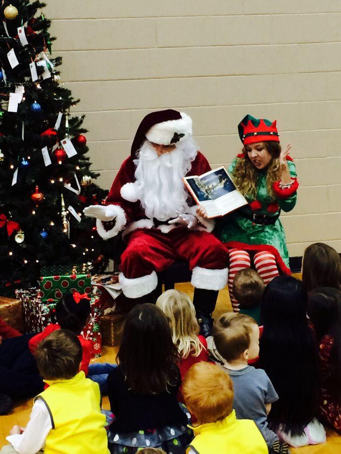 Jingles the elf reading and I doing motions