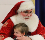 Santa gets a grateful hug