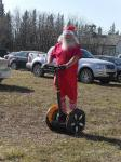 Santa on his Segway in one of his Summer Suits