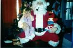 santa with his lil girl on his lap-not happy !