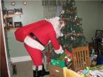 santa in front of the tree.jpg