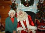 Bon Bon the Elf and Santa Pose for a Photo.
