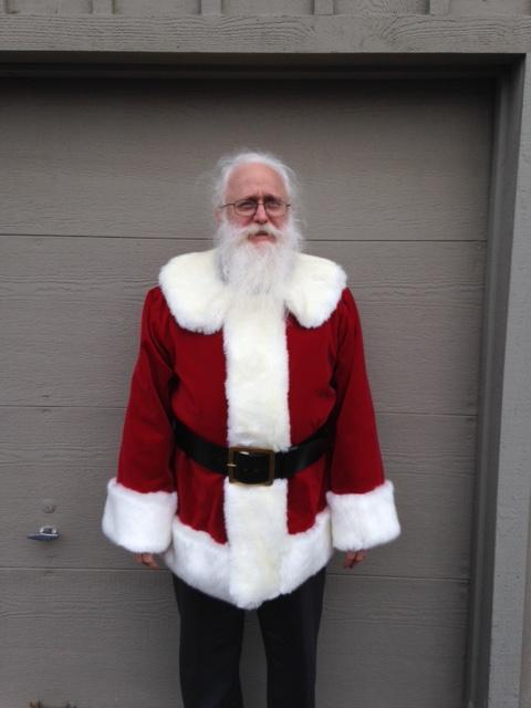 Santa Rich wearing a traditional fur front mock up in crimson red cotton velvet