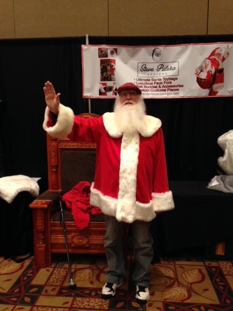 Santa Jim giving a stiff armed wave:)