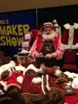 Mr. Joe Barney examining a reindeer:)