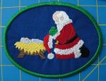 Santa kneeling at manger patch