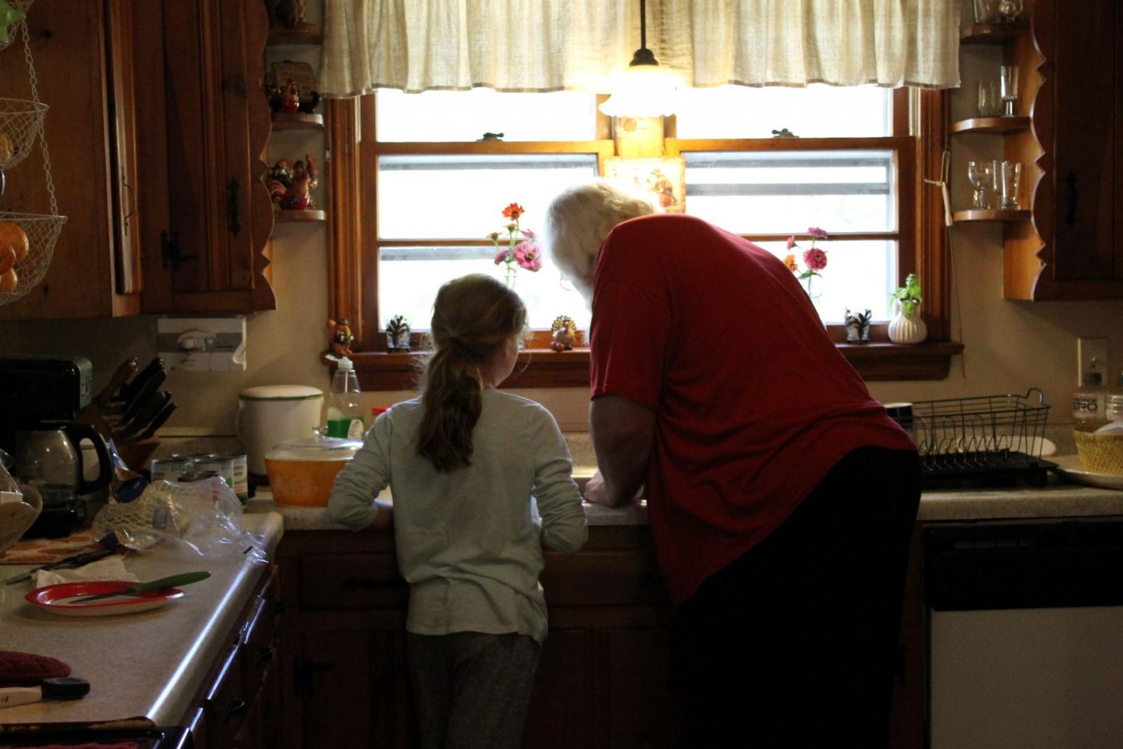 Granddaughter Maddie kitchen helper