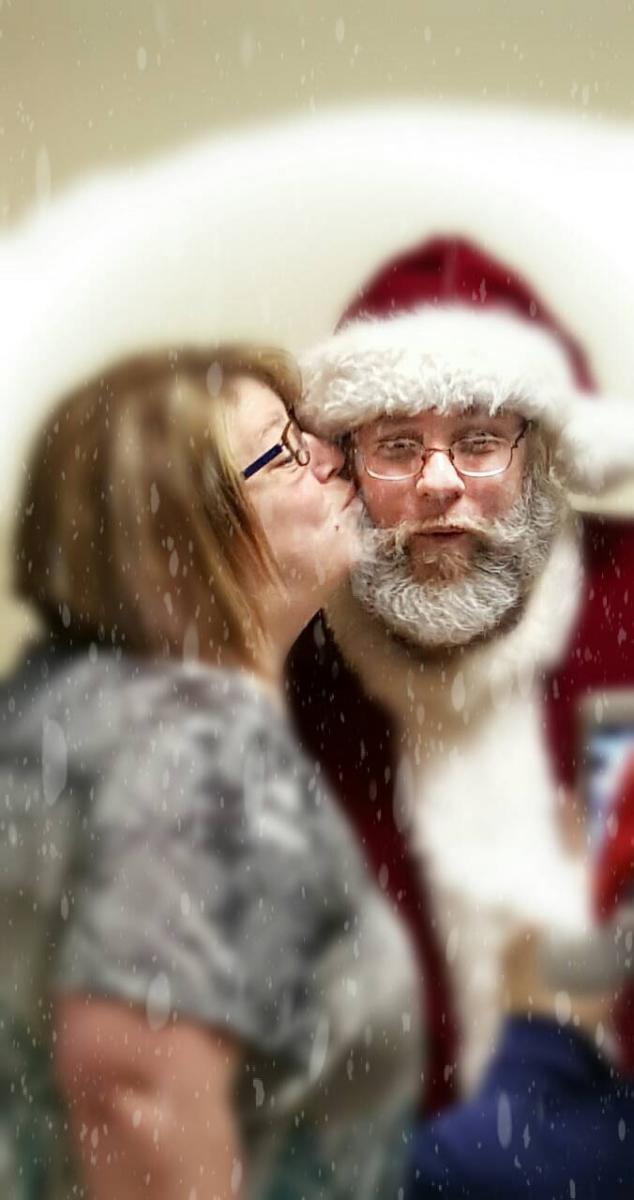 Santa gets a kiss of thanks