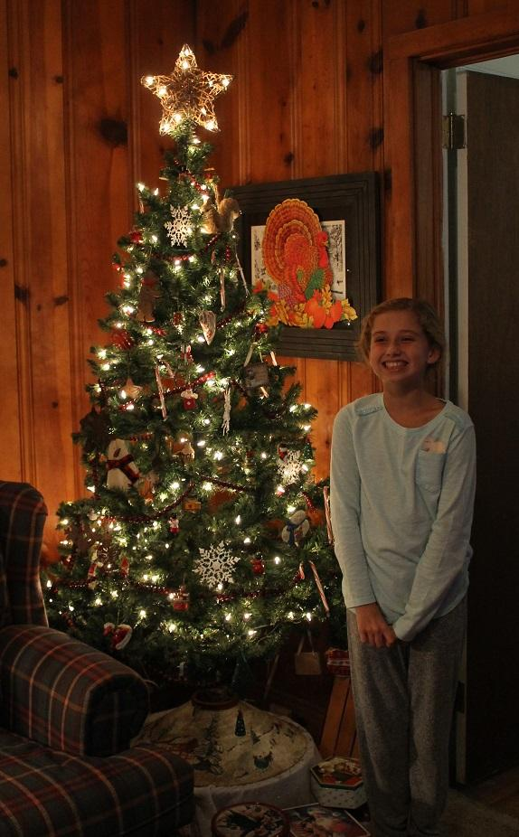 Granddaughter Maddie and tree 2018