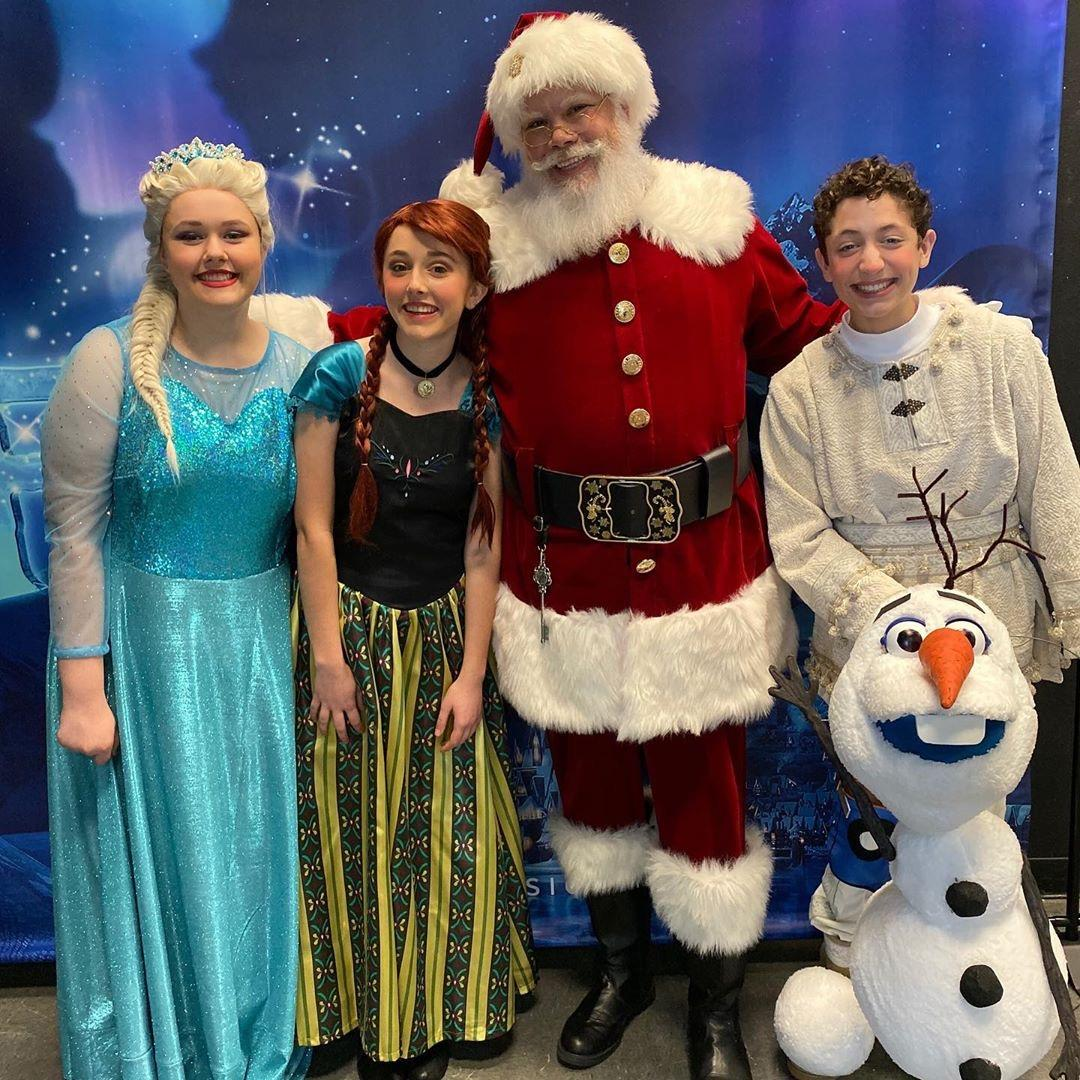 Santa and the cast of Frozen